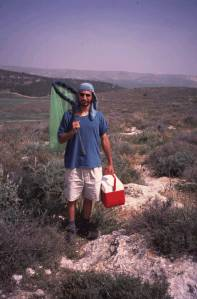 """Guy Pe'er when chasing hilltopping butterflies in Israel, long ago when doing his PhD. While his """"hilltopping model"""" is by now 12 years old, new results continue to emerge."""